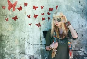 a woman looking through a peace and love glasses